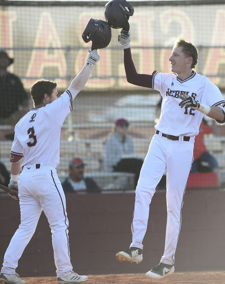 Lee's Adam Becker (12) celebrates with Ty Coleman (3) after scoring against Amarillo Tascosa March 15, 2018, at Ernie Johnson Field.  James Durbin/Reporter-Telegram Photo: James Durbin