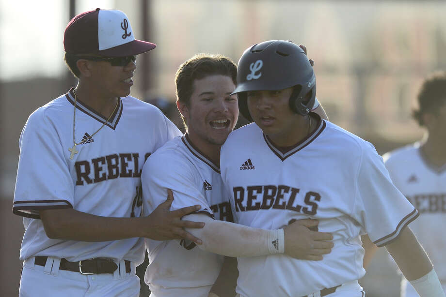 Lee's JJ Melendez (left), Ty Coleman (center), and Eli Salazar (right) celebrate a rally against Amarillo Tascosa March 15, 2018, at Ernie Johnson Field.  James Durbin/Reporter-Telegram Photo: James Durbin