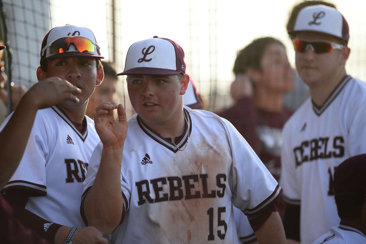 Lee's Austin Day (15) is congratulated after pitching against Amarillo Tascosa March 15, 2018, at Ernie Johnson Field. James Durbin/Reporter-Telegram