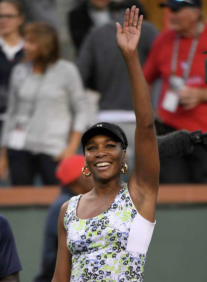 Venus Williams waves after defeatting Carla Suarez Navarro, of Spain, during the quarterfinals at the BNP Paribas Open tennis tournament, Thursday, March 15, 2018, in Indian Wells, Calif. (AP Photo/Mark J. Terrill) Photo: Mark J. Terrill / Copyright 2018 The Associated Press. All rights reserved.