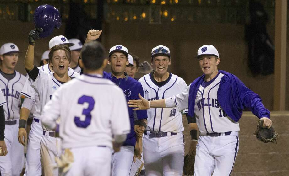 Willis players react after John Hernandez scores the game-winning run after back-to-back balks by Huntsville relief pitcher Jace Deveney during the sixth inning of a District 20-5A high school baseball game, Thursday, March 15, 2018, in Willis. Photo: Jason Fochtman/Houston Chronicle