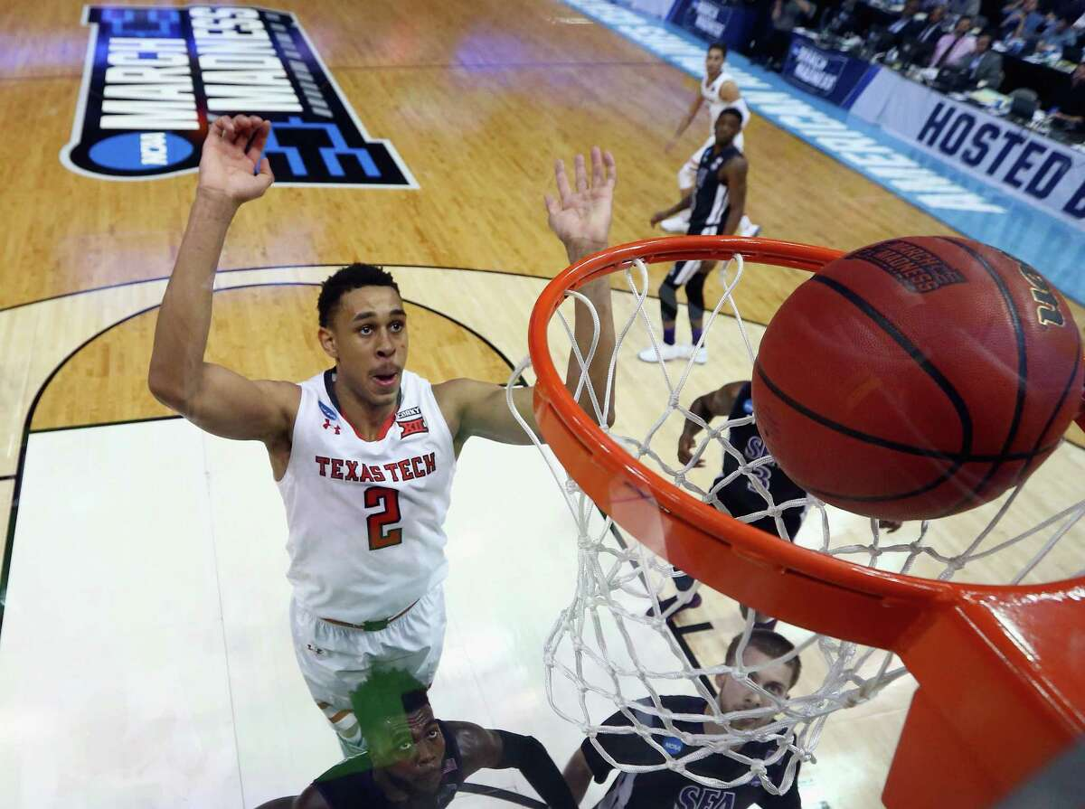 DALLAS, TX - MARCH 15: Zhaire Smith #2 of the Texas Tech Red Raiders shoots against Kevon Harris #1 and Ivan Canete #11 of the Stephen F. Austin Lumberjacks in the second half in the first round of the 2018 NCAA Men's Basketball Tournament at American Airlines Center on March 15, 2018 in Dallas, Texas. The Texas Tech Red Raiders won 70-60.