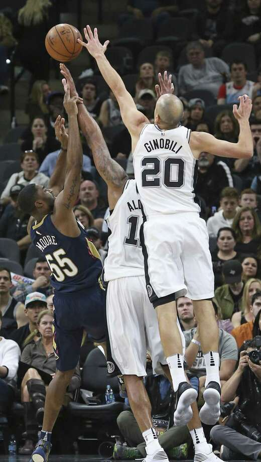 Manu Ginobili comes over to make sure a last minutes shot by E'Twaun Moore gets swatted away as the Spurs host New Orleans at the Alamodome on March 15, 2018. Photo: Tom Reel, Staff / San Antonio Express-News / 2017 SAN ANTONIO EXPRESS-NEWS