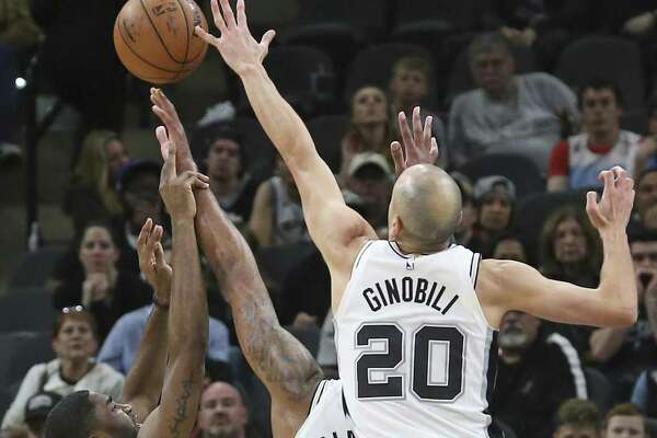 Manu Ginobili comes over to make sure a last minutes shot by E'Twaun Moore gets swatted away as the Spurs host New Orleans at the Alamodome on March 15, 2018.