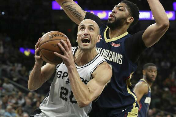 Manu Ginobili gets in front of Anthony Davis to get to the hoop as the Spurs host New Orleans at the Alamodome on March 15, 2018.