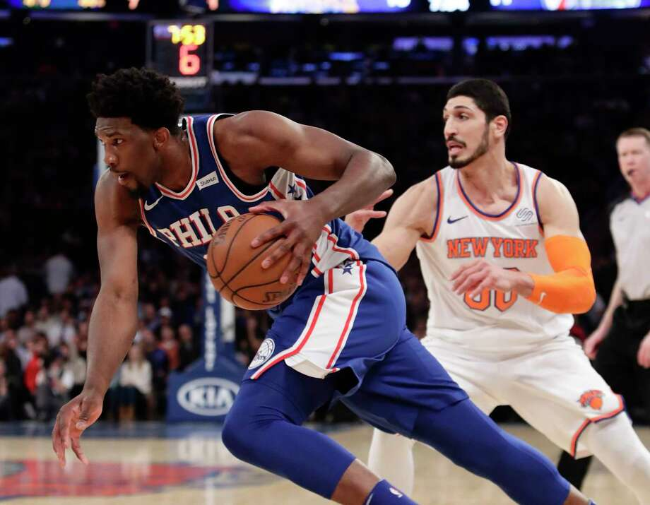 Philadelphia 76ers' Joel Embiid (21) drives past New York Knicks' Enes Kanter (00) during the first half of an NBA basketball game Thursday, March 15, 2018, in New York. (AP Photo/Frank Franklin II) Photo: Frank Franklin II / Copyright 2018 The Associated Press. All rights reserved.