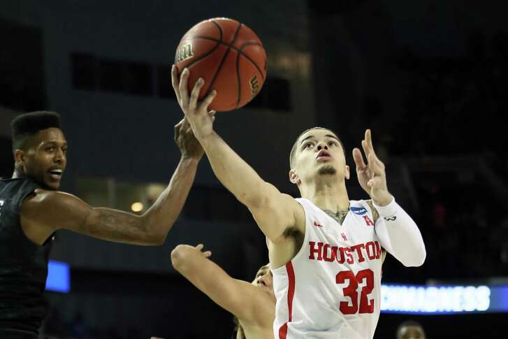 UH guard Rob Gray, right, squeezes between a pair of San Diego State defenders to score the winning layup with 1.1 seconds remaining in the first-round NCAA Tournament game Thursday night. It was the Cougars' first win in the event in 34 years.