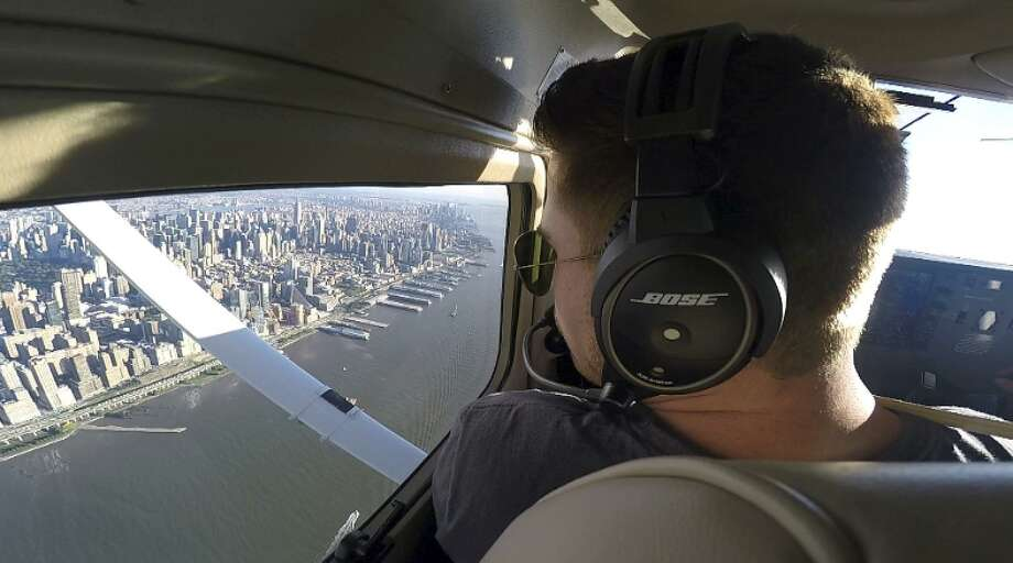 Aaron Ludomirski, certified flight instructor for Infinity Flight Group, flies over the Hudson River in New York. Major U.S. airlines are hiring pilots at a rate not seen since before 9/11, and that is encouraging more young people to consider a career in the cockpit. Photo: Joshua Replogle / Joshua Replogle / Associated Press File / ap