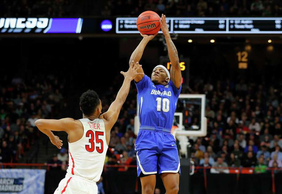BOISE, ID - MARCH 15:  Wes Clark #10 of the Buffalo Bulls shoots the ball against Allonzo Trier #35 of the Arizona Wildcats in the first half during the first round of the 2018 NCAA Men's Basketball Tournament at Taco Bell Arena on March 15, 2018 in Boise, Idaho.  (Photo by Kevin C. Cox/Getty Images) Photo: Kevin C. Cox / 2018 Getty Images