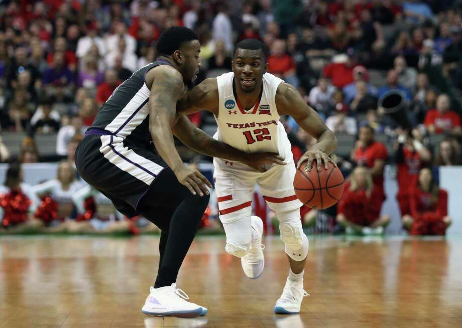 DALLAS, TX - MARCH 15: Keenan Evans #12 of the Texas Tech Red Raiders drives against Ty Charles #4 of the Stephen F. Austin Lumberjacks in the first half in the first round of the 2018 NCAA Men's Basketball Tournament at American Airlines Center on March 15, 2018 in Dallas, Texas.  (Photo by Ronald Martinez/Getty Images) Photo: Ronald Martinez / 2018 Getty Images