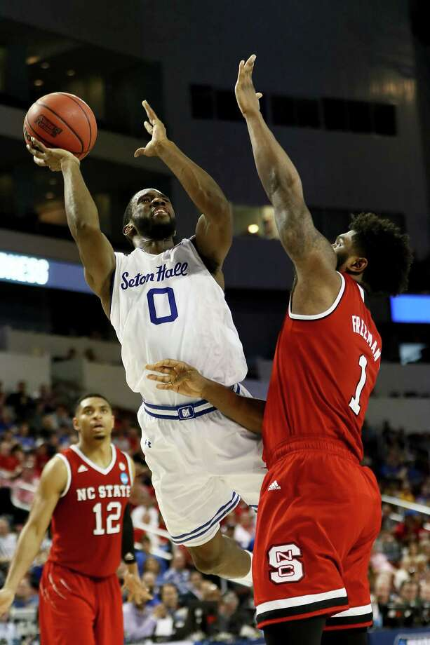 WICHITA, KS - MARCH 15:  Khadeen Carrington #0 of the Seton Hall Pirates attempts a shot while being guarded by Lennard Freeman #1 of the North Carolina State Wolfpack in the second half during the first round of the 2018 NCAA Tournament at INTRUST Arena on March 15, 2018 in Wichita, Kansas. (Photo by Jamie Squire/Getty Images) Photo: Jamie Squire / 2018 Getty Images