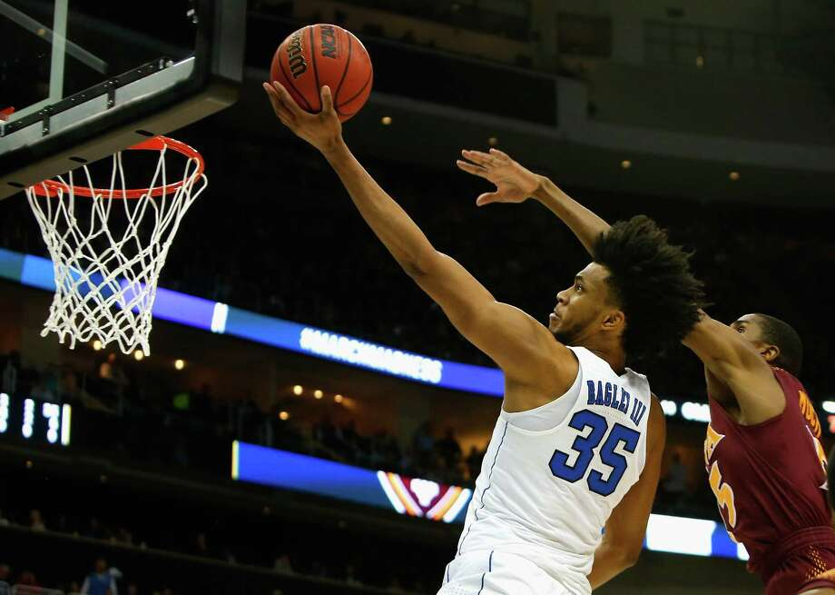 PITTSBURGH, PA - MARCH 15:  Marvin Bagley III #35 of the Duke Blue Devils gets a shot off against the Iona Gaels during the first half of the game in the first round of the 2018 NCAA Men's Basketball Tournament at PPG PAINTS Arena on March 15, 2018 in Pittsburgh, Pennsylvania.  (Photo by Justin K. Aller/Getty Images) Photo: Justin K. Aller / 2018 Getty Images