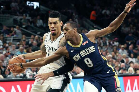 Danny Green presses the ball down the court against Rajon Rondo as the Spurs host New Orleans at the Alamodome on March 15, 2018.