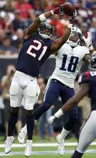 Houston Texans defensive back Marcus Gilchrist (21) jumps in front of Tennessee Titans wide receiver Rishard Matthews (18) to intercept a Matt Cassel pass during the fourth quarter of an NFL football game at NRG Stadium on Sunday, Oct. 1, 2017, in Houston. ( Brett Coomer / Houston Chronicle )