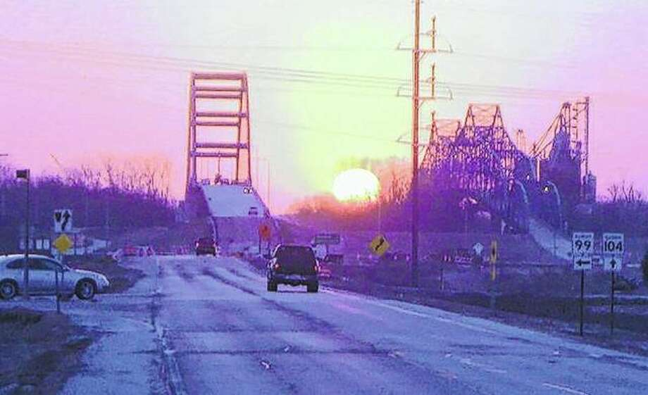 New and old bridges frame the sunrise in Meredosia.