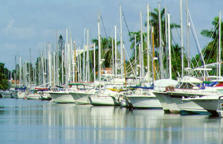 "A Florida man pleaded guilty to bilking a dozen investors in Connecticut and elsewhere by enrolling them in a purported ""sharing"" club promising them the use of luxury yachts globally, but leaving them high and dry after paying out hefty commissions to two people hired to bring in more investors. Photo: Greater Fort Lauderdale Conventi / Greater Fort Lauderdale Conventi / handout"