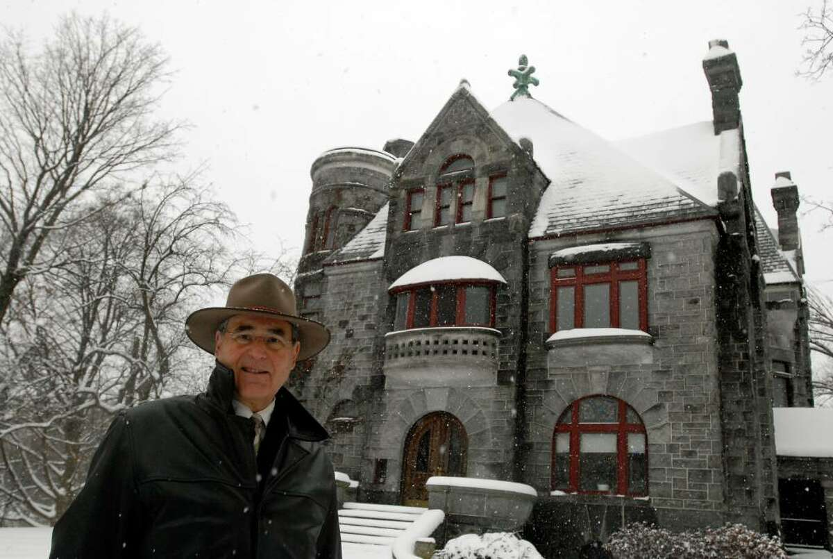 Commercial Realtor Thomas Sinopoli stands outside 10 Thurlow Terrace, a mansion on the edge of Washington Park in Albany that's for sale. (Cindy Schultz / Times Union)