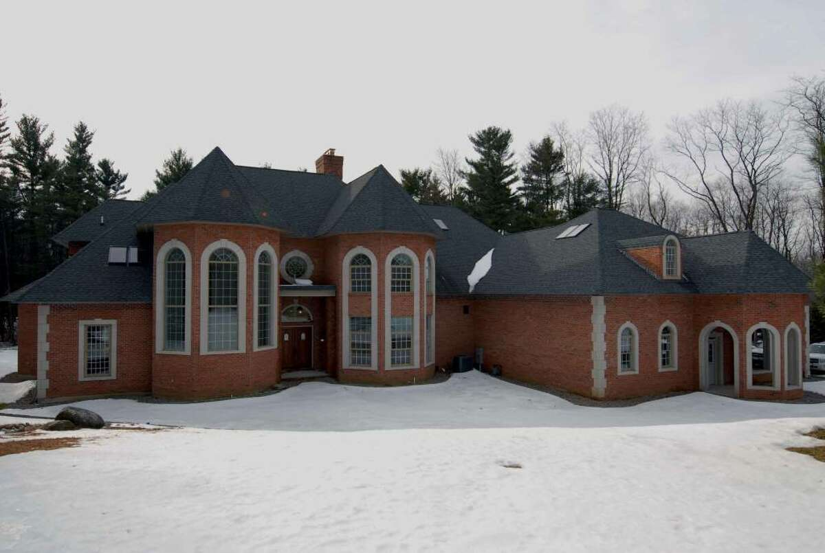 This 11,500-square-foot mansion on East Lydius Street in Guilderland has been on the market since 2008. (Michael P. Farrell / Times Union)