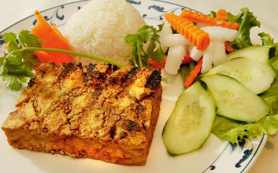 The grilled tofu steak is marinated in lemongrass before cooking, then served with rice and vegetables. (Luanne M. Ferris / Times Union) Photo: LUANNE M. FERRIS / 000006012A