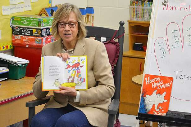 State Rep. Terrie Wood, R-141, read a Dr. Seuss book to a class at Royle School in Darien on March 2, Read Across America Day.