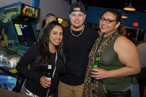 A new Slacker's opened on the St. Mary's Strip as revelers celebrated March Madness and a Spurs win on Thursday, March 15, 2018. The new spot is the third Slackers, a sports bar with a retro shopping mall arcade feel, in San Antonio.