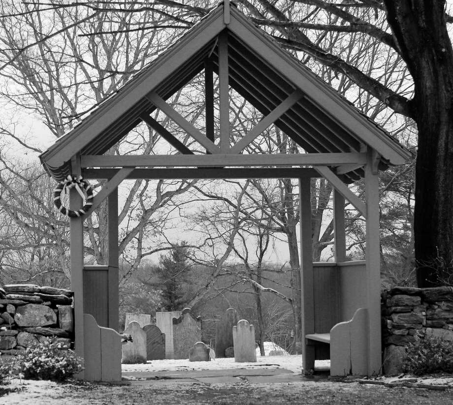 At the gateway to a cemetery in the Greenfield Hill section of Fairfield. Photo: Genevieve Reilly / Hearst Connecticut Media / Fairfield Citizen