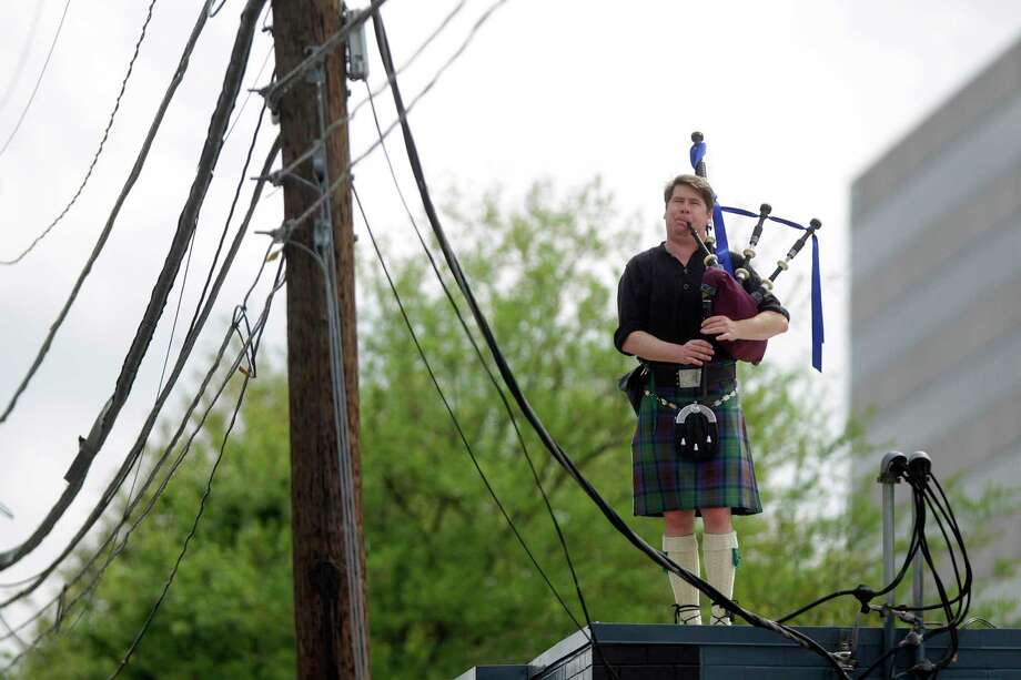 Bagpiper E.J. Jones begins St. Patrick's Day playing tunes on his bagpipes on top of McGonigel's Mucky Duck Thursday morning, March 17, 2016, in Houston. Jones has been taking part in the tradition for 20 years, citing the bar as the reason he has a career playing music. ( Mark Mulligan / Houston Chronicle ) Photo: Mark Mulligan, Staff / © 2016 Houston Chronicle