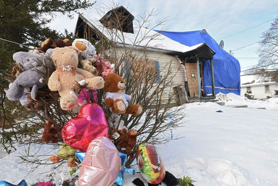 The home in which a mother, her son and grandmother died Sunday as a result of a devastating fire has been boarded up and wrapped in blue tarp on Friday, March 16, 2018 in Rensselaer, N.Y. (Lori Van Buren/Times Union) Photo: Lori Van Buren, Albany Times Union / 20043235A
