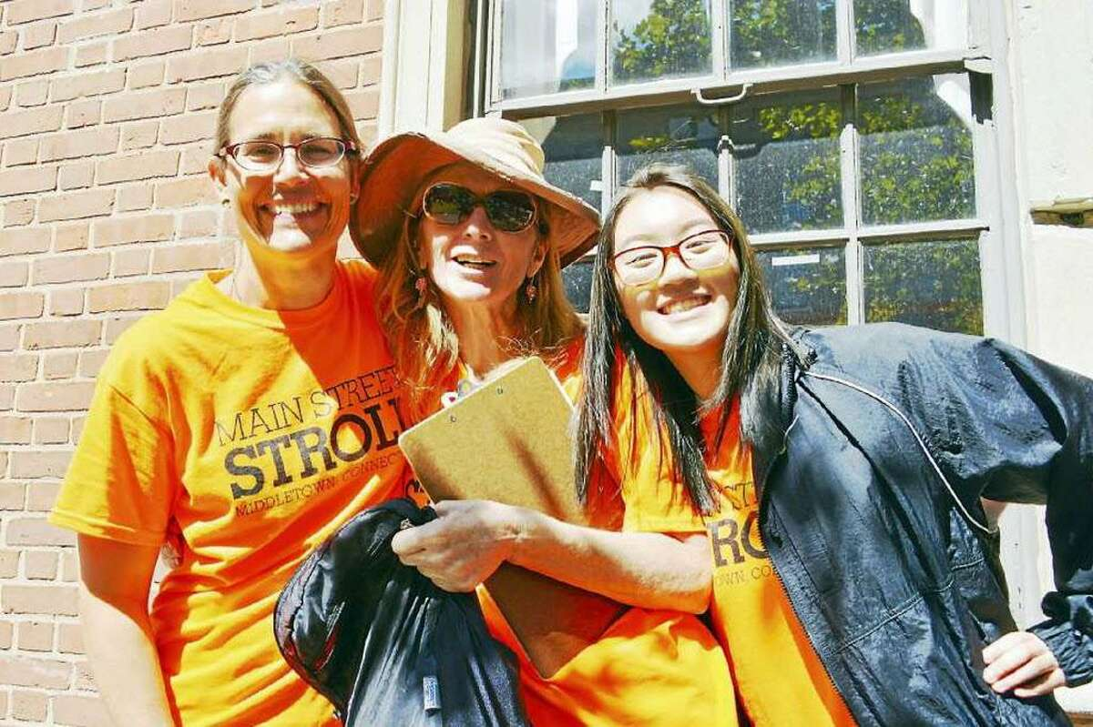 Shown from left are Rani Arbo, campus and community engagement manager at Wesleyan University; and volunteers Lucy McMillan and Sarah Nguyen, a Middletown High School senior, at the Main Street Stroll in September 2017.