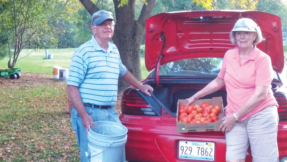 Steve and Charlotte Blackledge deliver a load of vegetables last year from the mission garden at St. John's United Methodist Church. Photo: For The Intelligencer