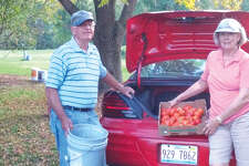 Steve and Charlotte Blackledge deliver a load of vegetables last year from the mission garden at St. John's United Methodist Church.