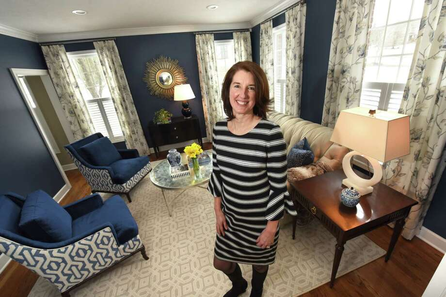 Meghan Baltich, the grand prize winner in a home design contest, stands in the winning room which is a living room in Traci and Joseph Roberto's home on Monday, March 12, 2018 in Loudonville, N.Y. (Lori Van Buren/Times Union) Photo: Lori Van Buren / 20043190A