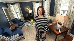 Meghan Baltich, the grand prize winner in a home design contest, stands in the winning room which is a living room in Traci and Joseph Roberto's home on Monday, March 12, 2018 in Loudonville, N.Y. (Lori Van Buren/Times Union)