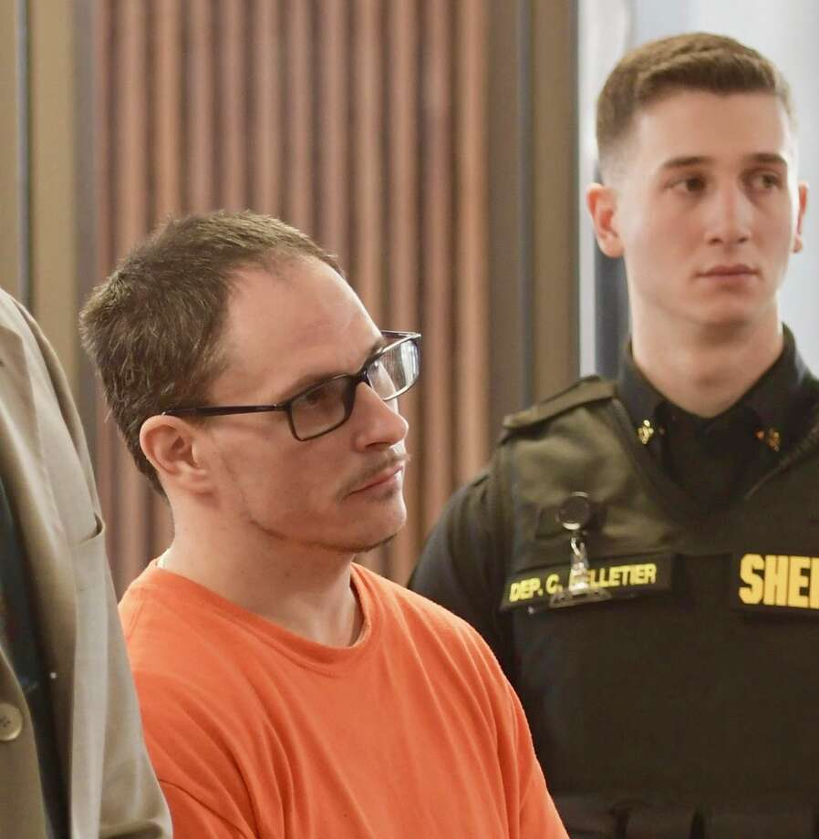Nicholas A. Dayter is arraigned in Albany City Court on Friday after sheriff's investigators charged him with making up a story that other prisoners at the Albany County jail were plotting to have state Supreme Court Judge Thomas Breslin killed. Photo: Skip Dickstein / Times Union
