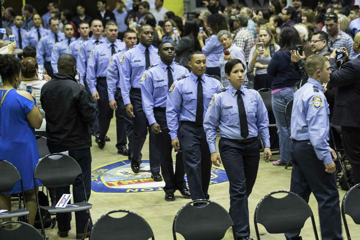 Firefighter cadets march in to the graduation ceremony for the Houston Fire Department Cadet Class 2018-A at the Val Jahnke Training Facility on Thursday, March 8, 2018, in Houston. ( Brett Coomer / Houston Chronicle )