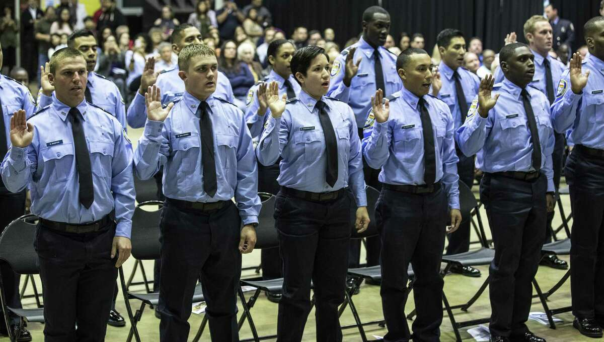 New firefighters take the oath of office during the graduation ceremony for the Houston Fire Department Cadet Class 2018-A at the Val Jahnke Training Facility on Thursday, March 8, 2018, in Houston. ( Brett Coomer / Houston Chronicle )