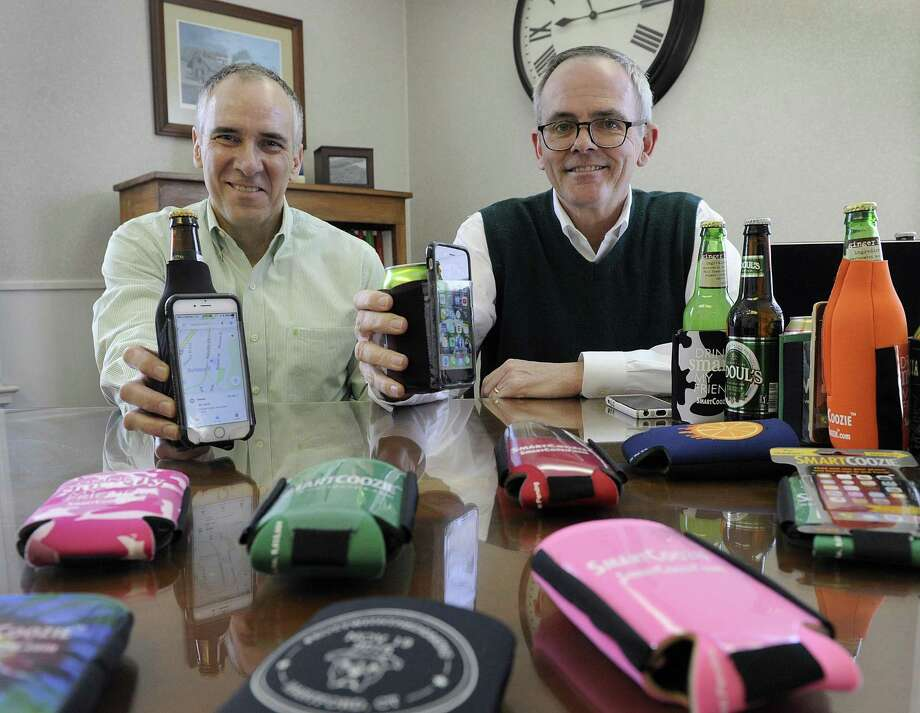 Ralph Tremaglio, left, and Tim Deakin have invented and patented  a bottle or can holder that also holds your smart phone in a touchable pocket. Photo Thursday, March 15, 2018. Photo: Carol Kaliff / Hearst Connecticut Media / The News-Times