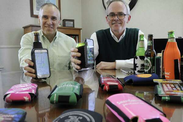 Ralph Tremaglio, left, and Tim Deakin have invented and patented  a bottle or can holder that also holds your smart phone in a touchable pocket. Photo Thursday, March 15, 2018.