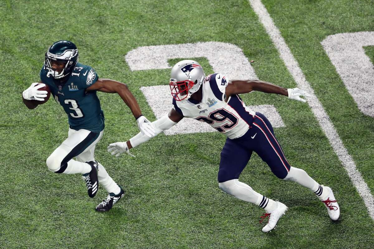 MINNEAPOLIS, MN - FEBRUARY 04: Nelson Agholor #13 of the Philadelphia Eagles is pursued by Johnson Bademosi #29 of the New England Patriots during the third quarter in Super Bowl LII at U.S. Bank Stadium on February 4, 2018 in Minneapolis, Minnesota. (Photo by Christian Petersen/Getty Images)