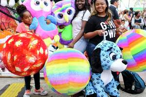 "Mariah Mitchell, 11, from left, poses with her cousins Jurnee, 16, and Tanrra Young, 15, with their big winnings. The Humble residents get a lot of basketball practice in at home and were able to translate their skills this year on the midway. ""Usually we just win small items, but this year, we just keep winning big!"" said Tanarra.  Lucky attendees show off their winnings from the midway at Houston Livestock Show and Rodeo at NRG Stadium on  on Thursday, March 15, 2018, in Houston."