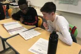 AITE seniors Michael Lindsay and Garrick LeClue race to complete a challenge during a Latin-themed Amazing Race at Academy of Information Technology and Engineering High School in Stamford, Coon..