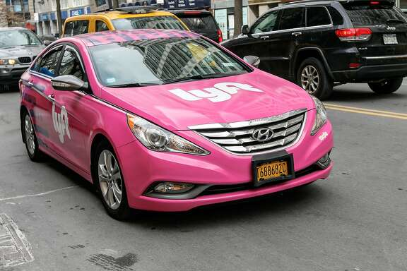 The ride-hailing service Lyft announced it will partner with major automobile industry supplier Magna to develop driverless vehicle systems. (Roman Tiraspolsky/Dreamstime/TNS)