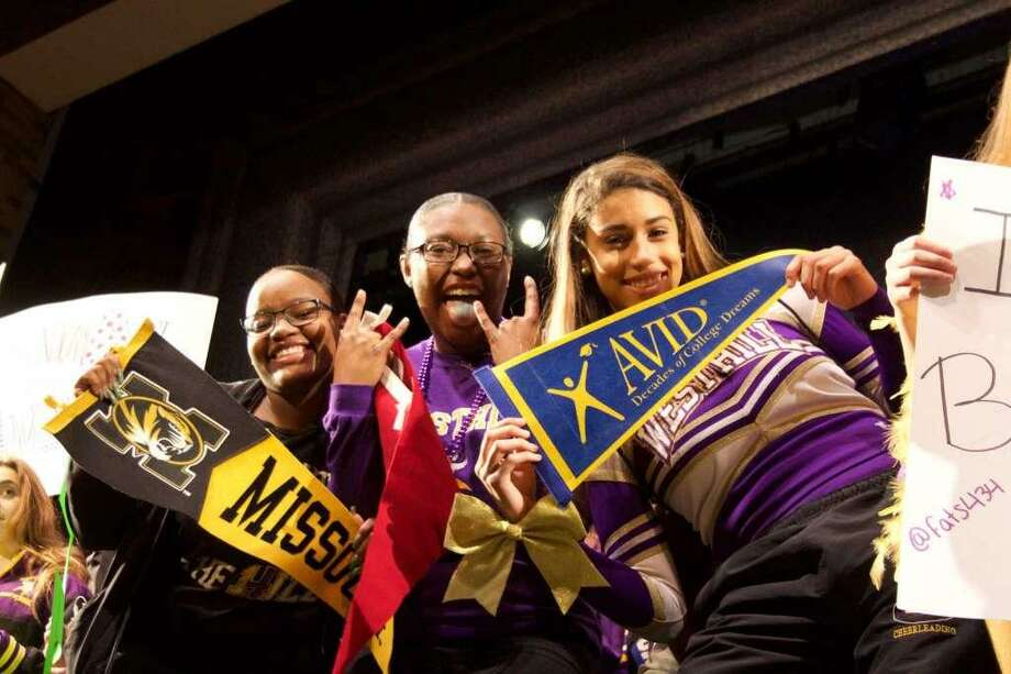 "Seniors Essence Mitchell, Tyona Green, and Chelsea Valdez representing their activity AVID (Advancement Via Individual Determination) - which seeks to close the achievement gap by preparing all students for college readiness - in the ""Hey Ya!"" scene in the auditorium during the Westhill lip dub video. Photo: Contributed Photo"