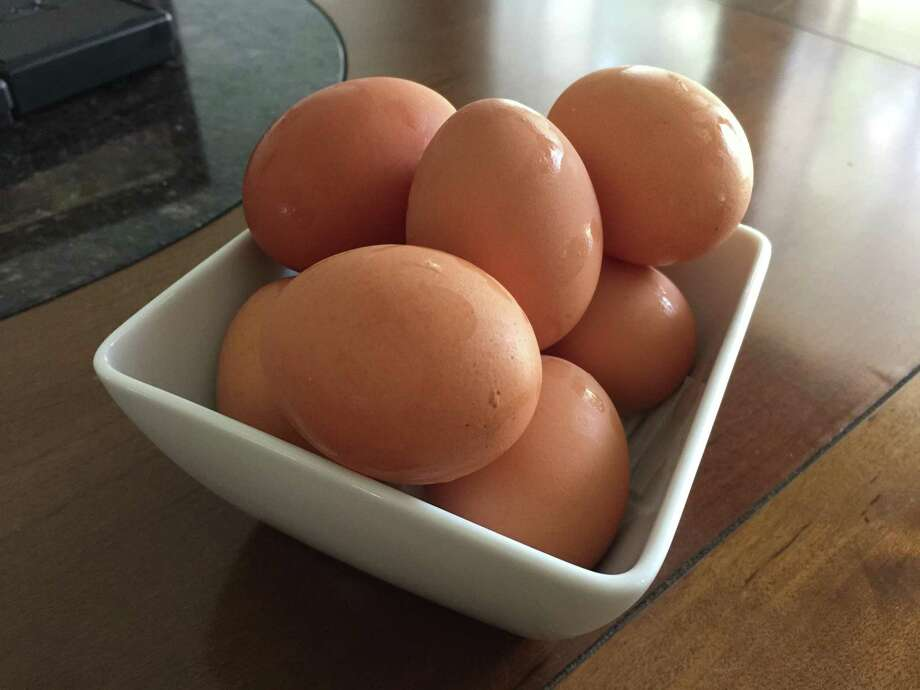 The best method I've found for boiling and peeling eggs to produce the cleanest, least-scarred results starts with a thumbtack. Photo: Emily Spicer /San Antonio Express-News