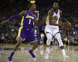 Golden State Warriors' Kevin Durant, right, is defended by Los Angeles Lakers' Kentavious Caldwell-Pope (1) during the second half of an NBA basketball game Wednesday, March 14, 2018, in Oakland, Calif. (AP Photo/Ben Margot)