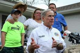 Gov. Greg Abbott speaks to the press after joining volunteers from Eight Days of Hope, the Rebuild Texas Fund, Michael and Susan Dell Foundation and 4B Disaster Response Networkon to visit the Sears family whose home was damaged in Hurricane Harvey Friday, March 16, 2018, in Dickinson. From left: Justice Sears, 11, Virgil and Brandy Sears, and Eight Days of Hope Executive Director and Co-Founder Steve Tybor III.