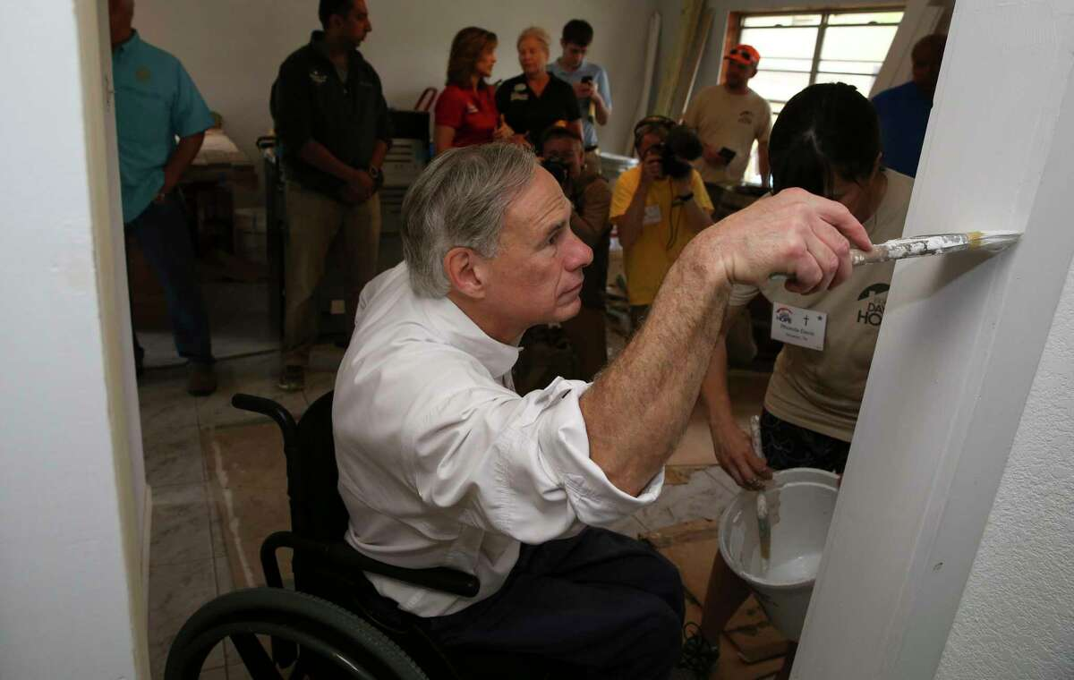Gov. Greg Abbott helps painting a livingroom wall of the Sears family whose home was damaged in Hurricane Harvey Friday, March 16, 2018, in Dickinson. Abbott joined volunteers from Eight Days of Hope, the Rebuild Texas Fund, Michael and Susan Dell Foundation and 4B Disaster Response Networkon who helped rebuilding to visit the Sears family.