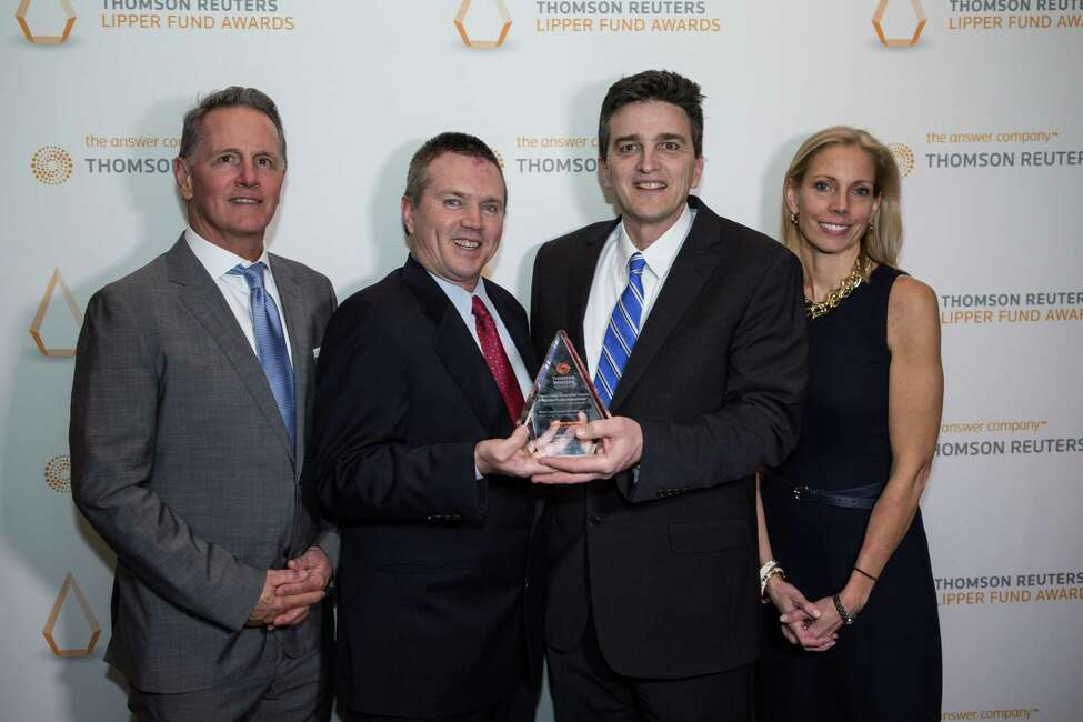 The Adirondack Funds in Guilderland recently won a Thomson Reuters Lipper award for the 10-year investment return performance of the Adirondack Small Cap Fund. Pictured from left are research director Tim Long, portfolio managers Matt Reiner and Greg Roeder, and director of investor relations Alicia Lasch.