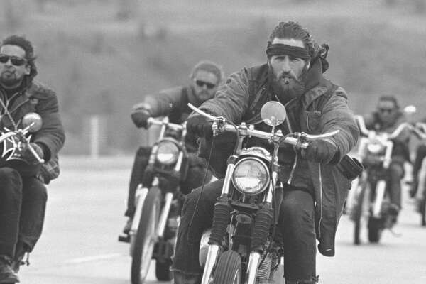 Members of the Hells Angel motorcycle club ride together towards Bakersfield, California, 1965.