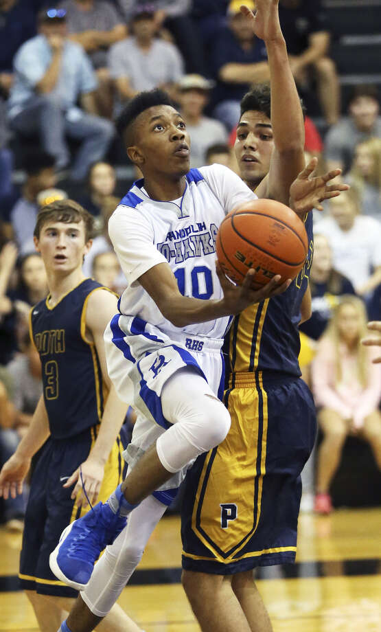 Randolph's Aaron Heyward shoots a layup during a Class 3A playoff game against Poth on Feb. 28, 2017. (Staff photo)